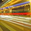 High speed traffic and blurred light trails under overpass — Foto Stock #7536019