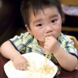 Eating baby to grab pasta — Foto de Stock