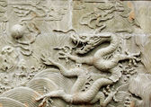 Dragon's relief sculpture — Stock Photo