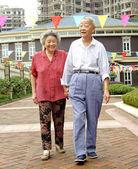 Happy senior couple are walking — Stock Photo