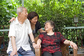 A happy family : a old couple and their children — Stock Photo