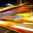 High speed and blurred bus light trails in downtown nightscape — Stock Photo #7548894