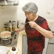Cooking grandma — Stock Photo #7564569
