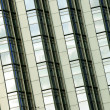 Tilted building feature with sparkling glass curtain wall — Stock Photo
