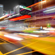 High speed and blurred bus light trails in downtown nightscape — Stock Photo #7626167