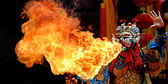 Chinese opera actor make a show of spouting fire — Stock Photo