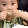 Stock Photo: Eating baby to grab pasta