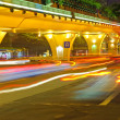 Stock Photo: High speed traffic and blurred light trails under the overpass
