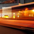 High speed and blurred bus light trails in downtown nightscape — Stock Photo #7652977