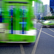 Stock Photo: High speed and blurred bus trails on downtown road