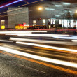 High speed and blurred cars light trails in downtown night scape - Stock Photo