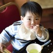 Stock Photo: A eating baby