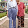 An intimate senior couple are walking — Stock Photo