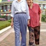 An intimate senior couple are walking — Stock Photo
