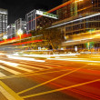 High speed and blurred bus light trails in downtown nightscape — Stock Photo #7653265