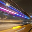 Stock Photo: High-speed vehicles blurred trails on urbroads