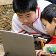 Stock Photo: Team ,partner and cooperation : boys concentrate on electronic d