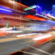 High speed and blurred bus light trails in downtown nightscape — Stock Photo #7655249