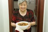 Cooking grandma — Stock Photo