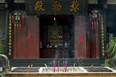 Incense altar in front of hall of the buddhist temple — Stock Photo