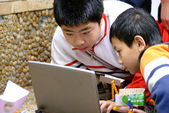 Team ,partner and cooperation : boys concentrate on electronic d — Stock Photo