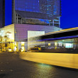High speed and blurred bus light trails in downtown nightscape — Stock Photo #7771864