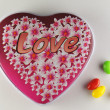 Love bonbonniere and colorful candies — Stok fotoğraf