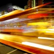 High speed and blurred bus light trails in downtown nightscape — Stock Photo #7773679