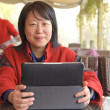 Smiling business woman with laptop — Stock Photo