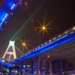 Bright lights under urban overpass - Stockfoto