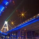 Bright lights under urban overpass — Stock Photo #7775724