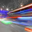 High-speed vehicles blurred trails on urban roads — Stock Photo