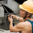 Stock Photo: Hardworking laborer on construction site