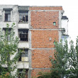 Stock Photo: Dilapidated tenement block will dismantled