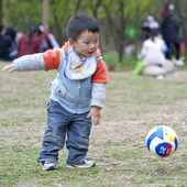 Baby playing football — Stock Photo