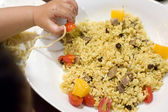 Eating baby to grab fried rice — Stock Photo