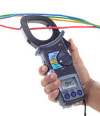 Man hand hold AC and DC clamp meter — Stock Photo