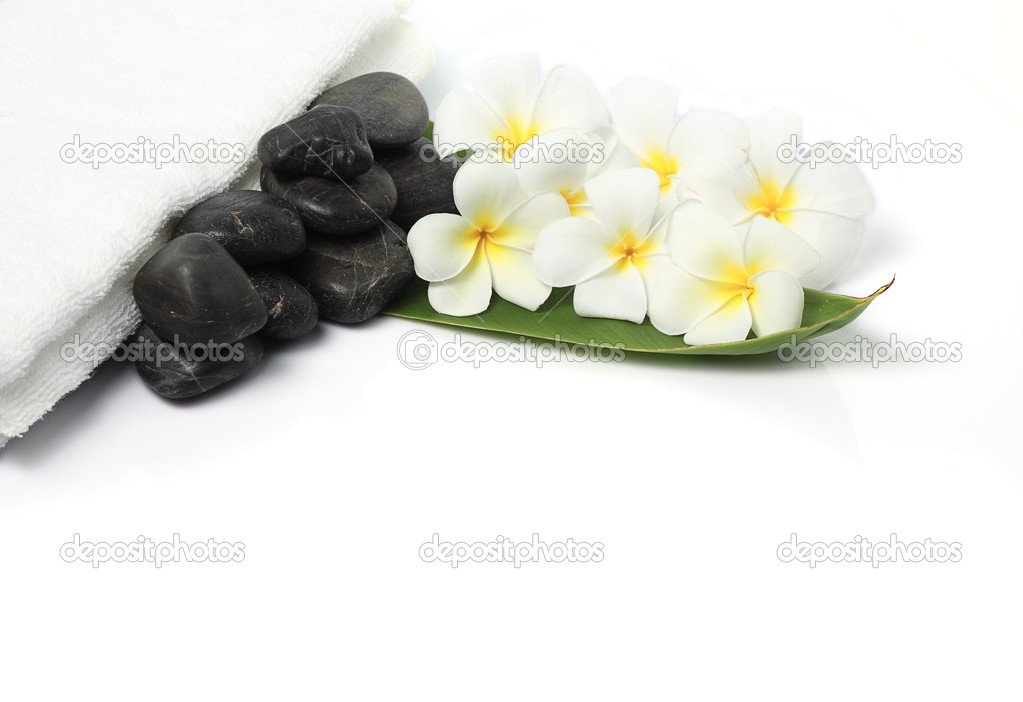 Spa still life with zen stones, frangipani flower, white towel and green leave  Stock Photo #7530979