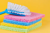 Kitchen brush and multi color sponges — Stock Photo