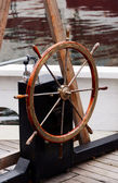 Wooden steering wheel on old sailboat — Stock Photo