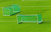 Football goals on football field — Stock Photo