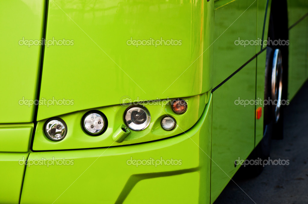 Green buss headlight with front wheel — Stock Photo #7809329