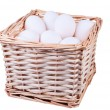 Wicker basket full of  chicken eggs — Stock Photo