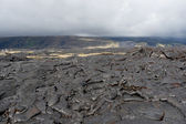 Volcanic lava field on Big island, Hawaii on cloudy day. — Stock Photo