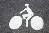 символ велосипедов на асфальте — Стоковое фото