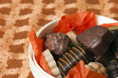 Part of Basket of chocolate on orange background — Stock Photo