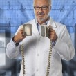 Doctor using a defibrillator — Stock Photo