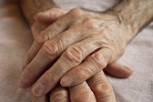 Old wrinkled hands — Stock Photo