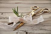 Scissors with rosemary and lace — Стоковое фото