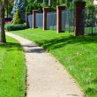 City Sidewalk Winds Through Neighborhood — Stock Photo #7604009